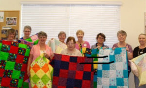 A picture of the ladies who are part of the legacy quilters.